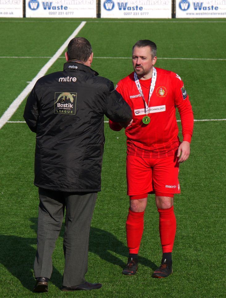 Man of the Match Nick Blue gets his winners medal for Cray