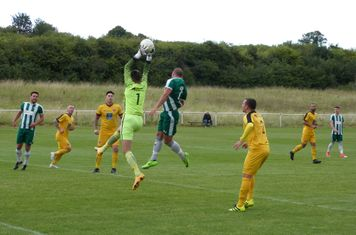 L. Newman goes up for the header