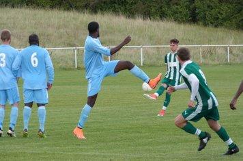 C. Evans striking the free-kick