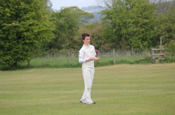 Sam Noble prepares to deliver the first ball of the match.