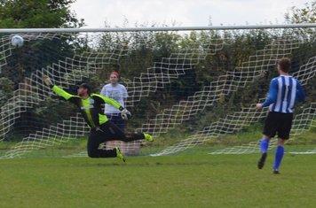 Callum Roberts fires high into the net