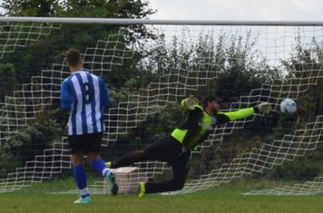 Emlyn Hauber scores the winning penalty