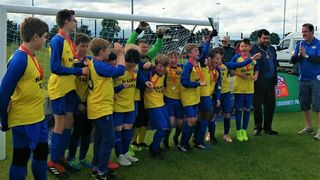 U12 Blues bring home the cup!