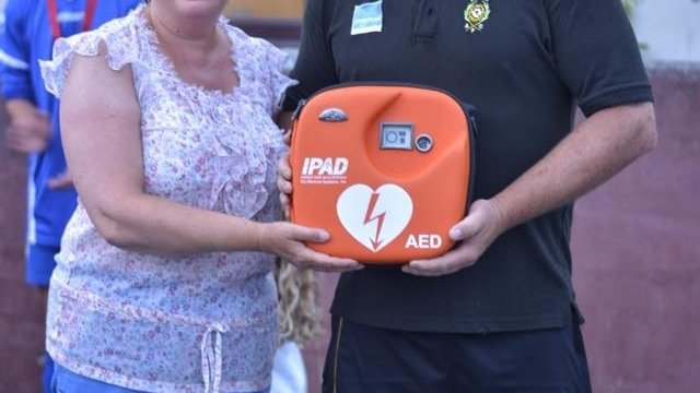 Hayle FC presented with life saving equipment
