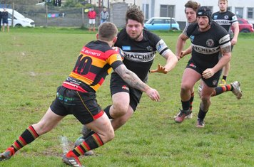Winscombe No 8 Will Thomas powers through for his second try
