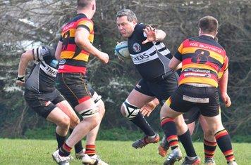 Replacement centre Chris Marsh glides through the Saltash defence