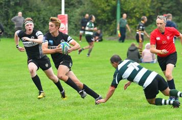 Winscombe flanker Aaron Ford steps his Bristol Saracens opposite number