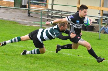 Winscombe wing Bryn Turner crosses for the first of his two tries against Bristol Saracens