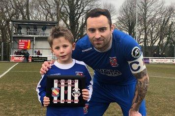 Matchday Mascot Levi James with Bangor City captain Danny Holmes (Photo Credit: Kevin Owen | Bangor City FC Media)