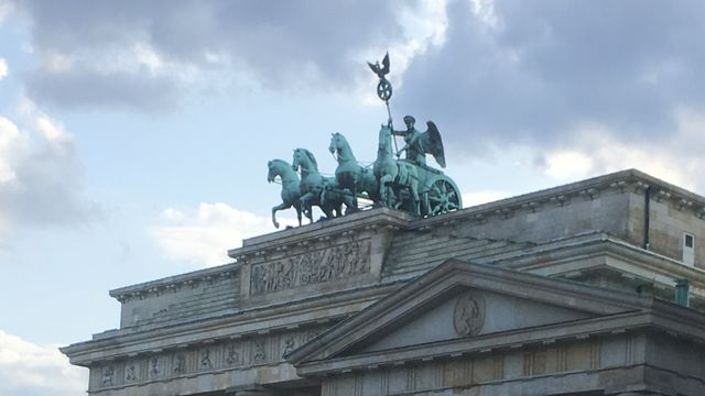 Bobble hat marches into Berlin.
