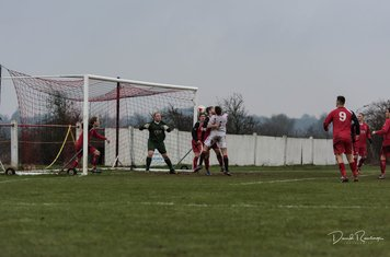Matty Hunt in a tussle v Coton Green (A) photo courtesy of David Rawlings