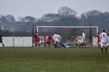 Oliver smothers the ball v Coton Green (A) photo courtesy of David Rawlings