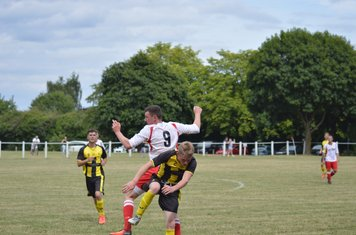 James Lemon in a tussle vs Kington Town - courtesy of Owen Morris