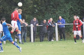 Chris Glover challenging for a header  vs FC Stratford - courtesy of Mathew Mason