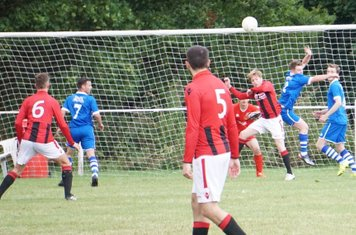 Haydn Morris challenging for a header  vs FC Stratford - courtesy of Mathew Mason