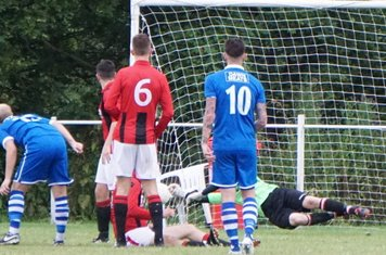 Matt Oliver makes a flying save  vs FC Stratford - courtesy of Mathew Mason