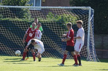 Mark Burrows' stooping header vs Fairfield Villa (A) photo courtesy of Mathew Mason