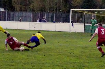 Matty Hunt wins a tackle v Alcester Town (H) - photo courtesy of Mathew Mason
