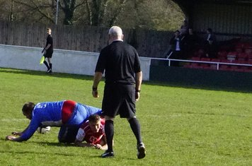 Dan Cottrill flattened under a challenge  v Bloxwich Town (H) photo courtesy of Mathew Mason