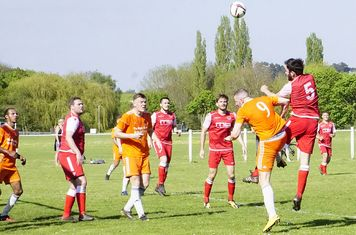 Mike Seeley wins a header v Montpellier (H @kgpf) -photo courtesy of Mathew Mason