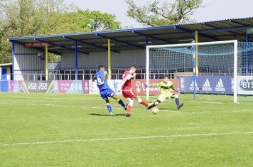 Lemon slides his shot under the 'keeper v Moors Academy (A) photo courtesy of Mathew Mason