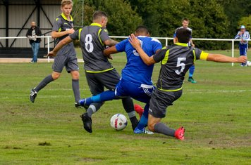Mike Seeley wins a tackle vs Darlaston Town (A) courtesy of DTFC