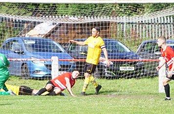 Crisp scrambles away Wenny's best chance - photo courtesy of Mathew Mason