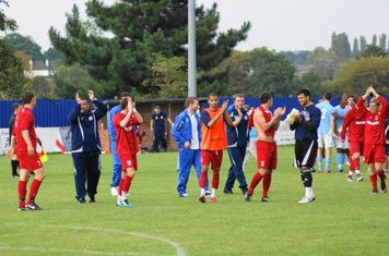 A good victory-players and managers salute the crowd.