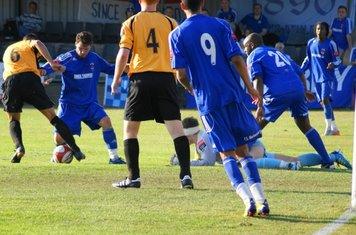 defender scrambles it away.