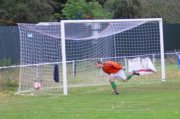 Goalkeeper standin glad to see this go by the post.