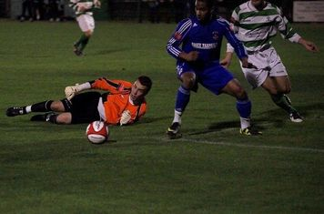 Ball runs loose-                                                                                                                                                     Mikey Cartwright Photo.