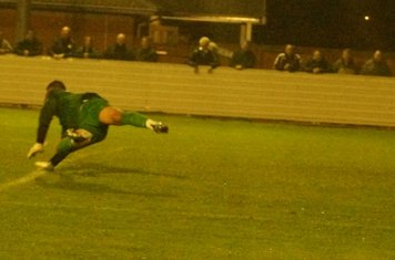 ...keeper dives unsucessfully..