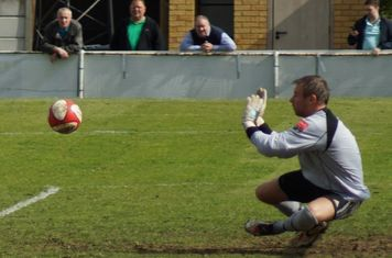 KEEPER PUSHES IT AWAY.
