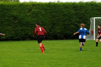 Bray worries the away defence with his fierce shot across goal.