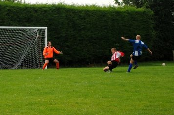 Pete Taylor sees his shot blocked just in time
