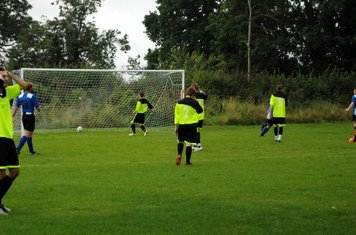 Stantonbury hold their heads as they watch their defence put the ball over their own line.