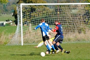 Tom Bush with another attempt to round the 'keeper.