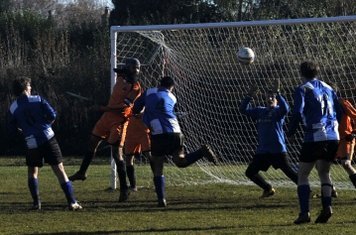 ...The ball is turned goalwards as Hawes looks on, it's just about to fall to his feet...