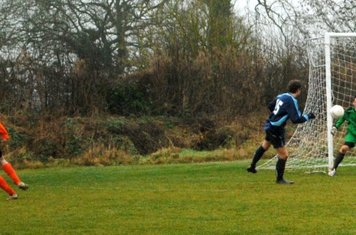 Pete Stiefel sees his shot curl around the keeper for United's first equaliser.