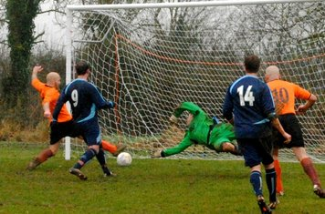 Pete Taylor latches onto Hinson's cross to seal victory.