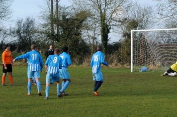 Dearlove looks on as his free-kick is pushed from danger.