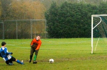 As United pressed for a winner, Dench got stuck in with the MK keeper...