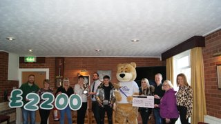 Clubs present charities with memorial game monies