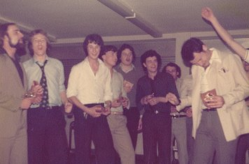 Wilson Bowers leads us in 'American Pie' at the COXA Football Section Dinner at the College 12/5/1979