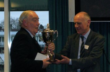 Colin Garvey being presented with the 'Colin Garvey' Trophy by Eddie O Brien