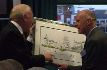Eddie O'Brien being presented with a water colour of the College by Chairman David Leathem