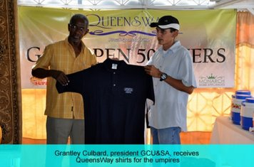 QUEENSWAY PRESENTS SHIRTS TO GEORGETOWN UMPIRES