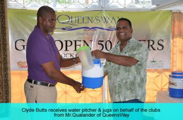 "CLYDE BUTTS COLLECTS A WATER PITCHER N BEHALF OF GNIC FROM QUEENSWAY CEO, MOHAMED ""ARAFAT"" QUALANDER"