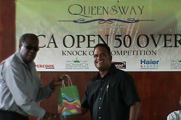 "MR CLIVE LLOYD RECEIVES ATOKEN FROM QUEENSWAT CEO, MOHAMED ""ARAFAT"" QUALANDER - 2012"