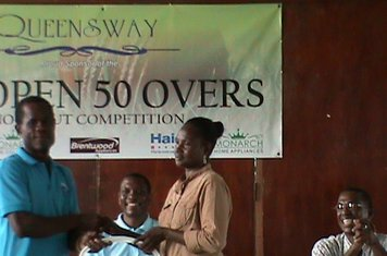 MS LAVERN FRASER RECEIVES A LARGE WATER PITCHER ON BEHALF OF UG - QUEENSWAY 2012